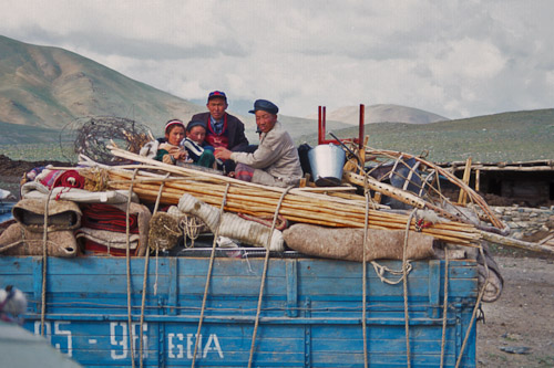 Herder family moving their ger by truck Bayan Olgii Mongolia