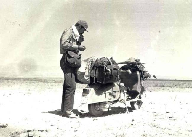 Roberto Patrignani photographed in Afghanistan on his way to Tokyo from Italy on a 1964 Vespa adapted to the purpose.