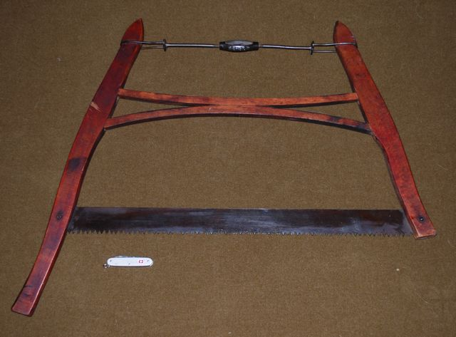 Firewood bucksaw, the grandfather of the family.