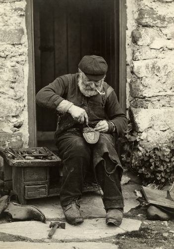 "Cobbler at work, no citation, no date. Click for ""source""."