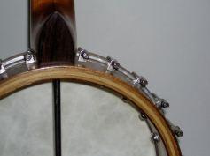 Cherry and walnut banjo with hickory laminates.
