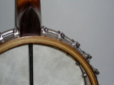 Cherry and walnut banjo with hickory laminates.