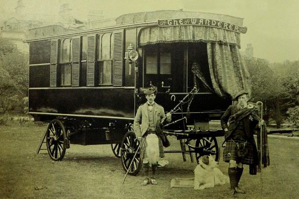 A couple of well dressed Scotsmen; Stables (right) and unknown man stand in front of the Wanderer. You get a real sense of the scale of this caravan in this image.