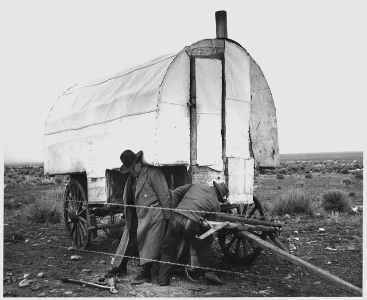 greasing the axles of a sheep camp n taos county new mexico ca 1941 - Sheep Wagon