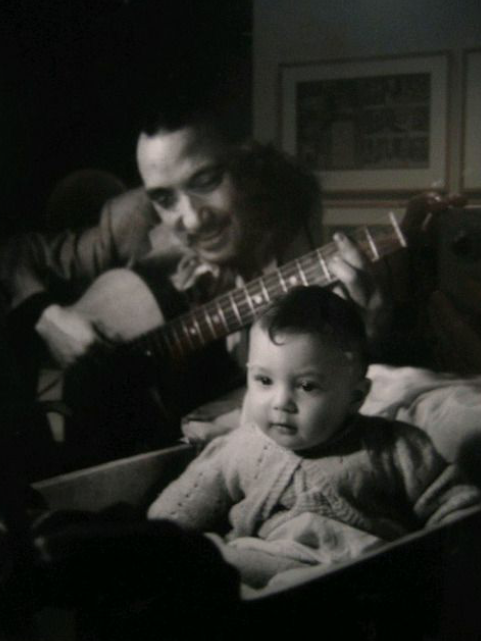 Django Reinhardt playing for his son Babik, 1944.
