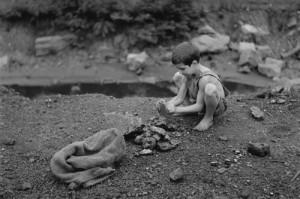 Boy-with-Rocks-500x333
