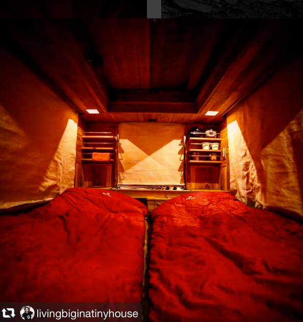 Roll down canvas curtains block the large windows for the night.
