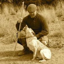The author with his antler-fork walking stick and his dog begging for a walk.