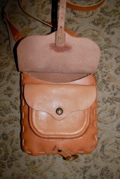 Large external pocket with button.